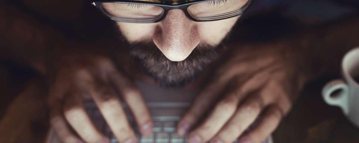 Man using computer in the dark