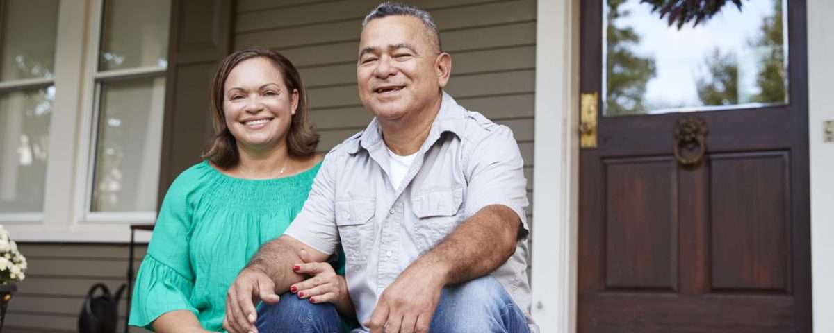 Retired couple sitting on porch